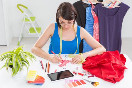 fashion design: Fashion designer working in studio. Close up design.