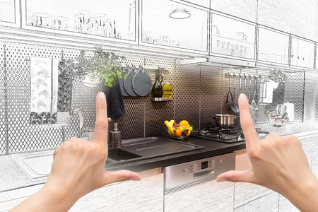 kitchens: Female hands framing custom kitchen design. Combination drawing and photo. Stock Photo