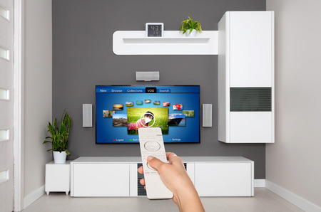 television remote: Video on demand VOD service on TV, television concept. Stock Photo