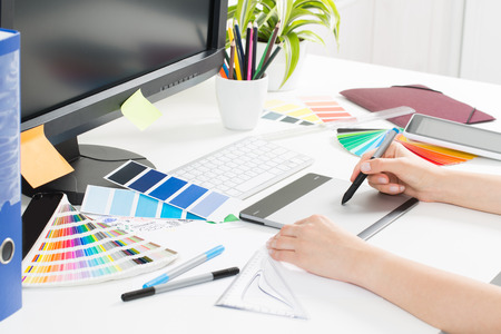 Graphic designer at work. Color swatch samples. Stock Photo - 43398558