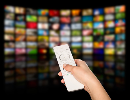 television: LCD TV panels. Television production technology concept. Remote control. Stock Photo