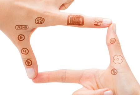 microstock: Hand symbol that means digital camera on white background.