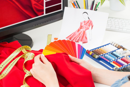 working dress: Fashion designer working in studio. Close up design.
