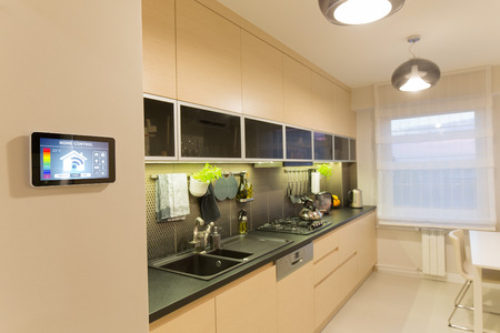 a kitchen: Remote home control system on a digital tablet or phone.