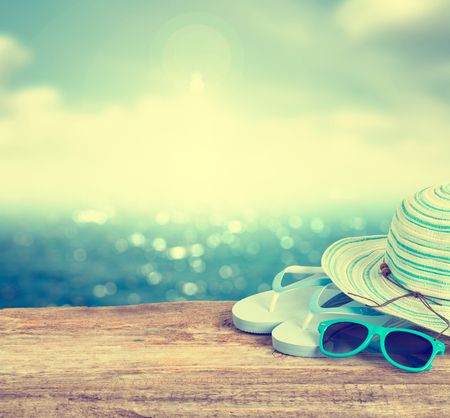 sunglasses: Beach accessories on wooden board. Concept of the summer time. Stock Photo