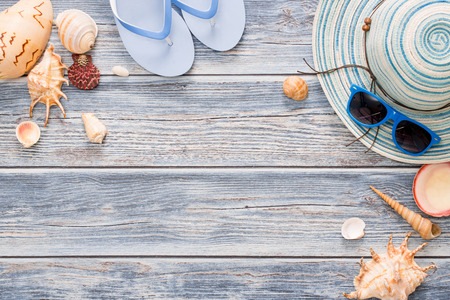 Beach accessories on wooden board. Concept of the summer time. Stock Photo