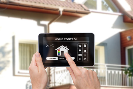 gadget: Remote home control system on a digital tablet or phone.