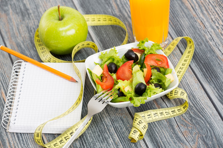 fruit juices: Workout and fitness dieting copy space diary on wooden table.