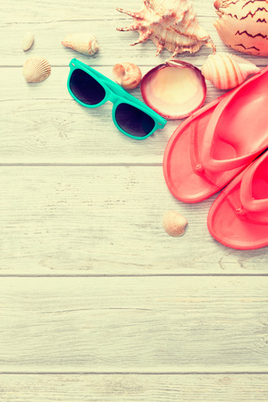 Beach accessories on wooden board. Concept of the summer time. Фото со стока
