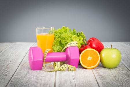 food healthy: Fitness concept with dumbbells and healthy food.