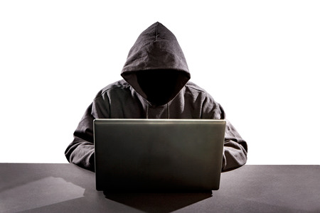 Hacker using laptop. Hacking the Internet. Banco de Imagens