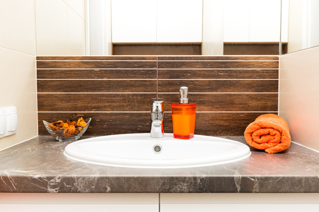 washbasin: Close up of a wash basin in a modern bathroom interior. Stock Photo