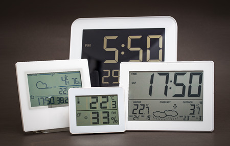 window display: Weather station device with weather conditions. Gray background. Stock Photo