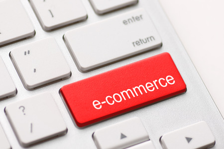 e commerce: Computer keyboard with e commerce key.