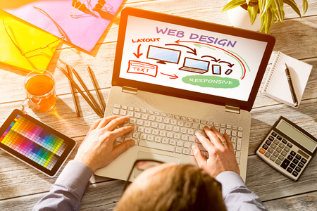 web site design: Designers desk with responsive web design concept.
