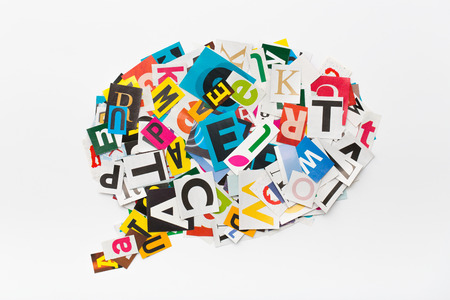 bubble letters: The colorful speech bubble in cut out magazine letters.
