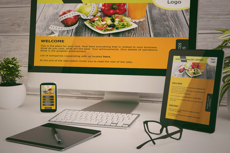 Designers desk with responsive web design concept.