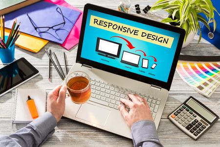 computer program: Designers desk with responsive web design concept.