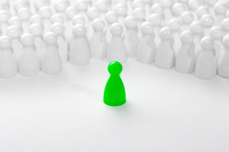 supervision: Leadership business concept with pawns.