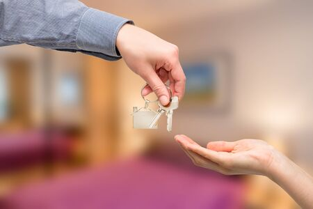 key: key home buy sale hand business owner estate real house - stock image