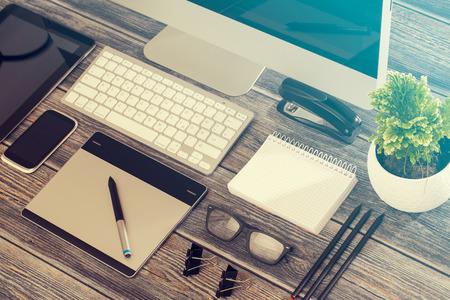 Designer's desk with responsive design mockup concept. Archivio Fotografico