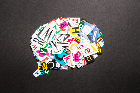 content: The colorful speech bubble in cut out magazine letters.