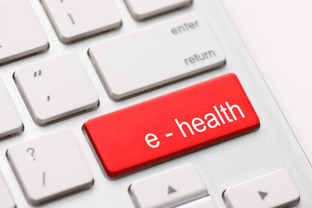 Computer keyboard with e health key. Stock Photo
