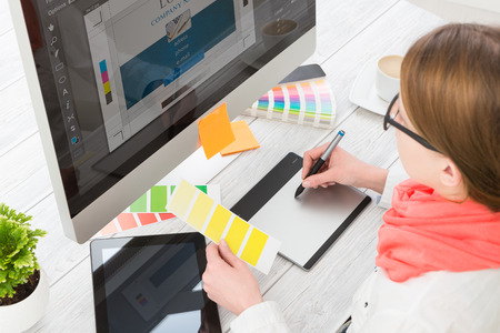 business graphics: Graphic designer at work. Color swatch samples.