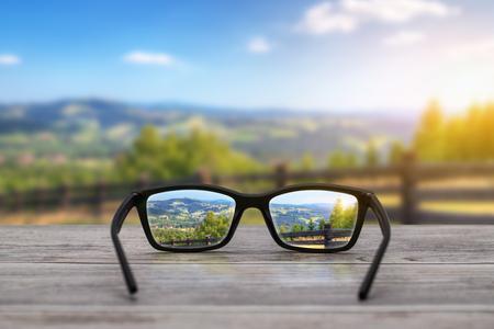 Occhiali concentrano sfondo di legno - immagini stock Archivio Fotografico - 56962894