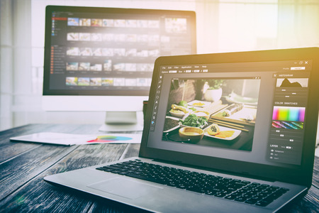 photographer camera editor monitor design laptop photo screen photography - stock image