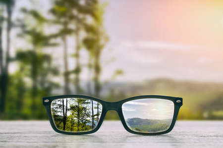 farsighted: glasses focus background wooden - stock image