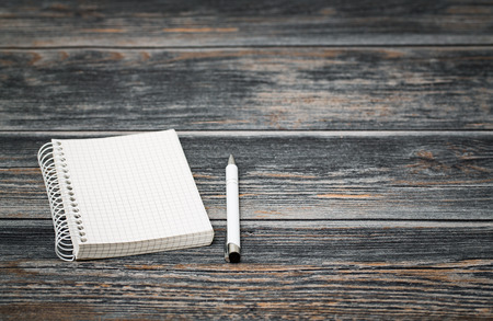 notebook paper background: notebook paper blank table pen background - stock image Stock Photo