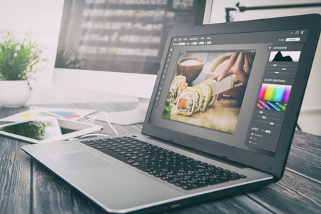 photographer camera editor monitor design laptop photo screen photography - stock image