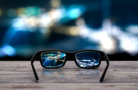 see through: glasses focus background wooden - stock image