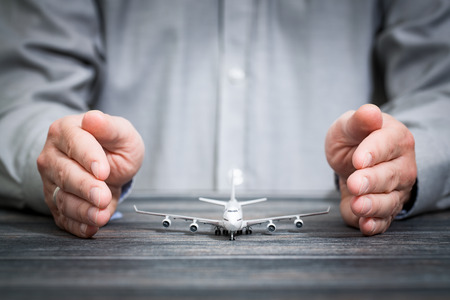 protection concept: travel insurance aircraft airplane protection plane safe protect concept - stock image