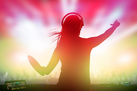 disc jockey: Charismatic disc jockey. Club, disco DJ playing and mixing music for crowd people.