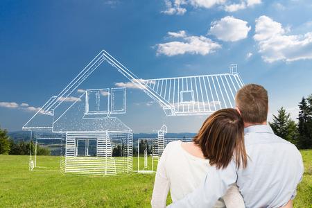Milující mladý pár při pohledu na dům snů.