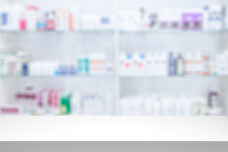 counter store table pharmacy background shelf blurred blur focus drug medical shop drugstore medication blank medicine pharmaceutics concept - stock image Stock Photo - 64976883