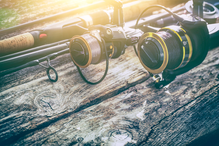 spinning reel: fishing rod gear background spinning wheel reel angler bait concept - stock image Stock Photo