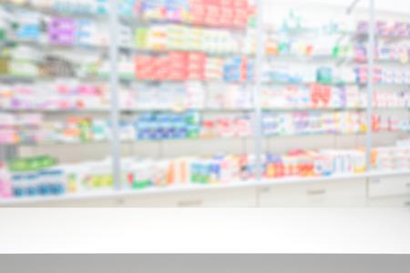 pharmaceutics: counter store table pharmacy background shelf blurred blur focus drug medical shop drugstore medication blank medicine pharmaceutics concept - stock image
