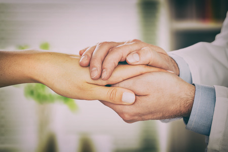 kindness: doctor patient care holding human hand trust touch medical thanks help clinic health concept - stock image Stock Photo