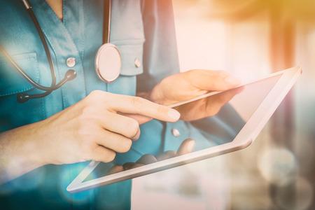 doctoring: doctor digital tablet medicine practice intern patient health background concept - stock image