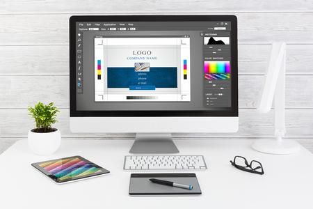 designer: Graphic designer at work. Color swatch samples.
