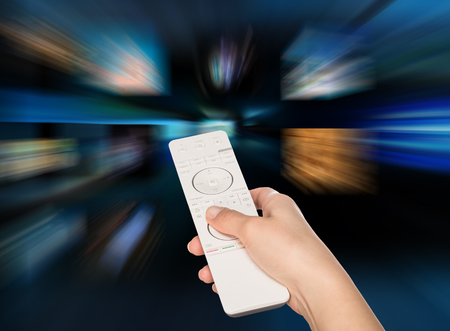 television production: LCD TV panels. Television production technology concept. Remote control. Stock Photo