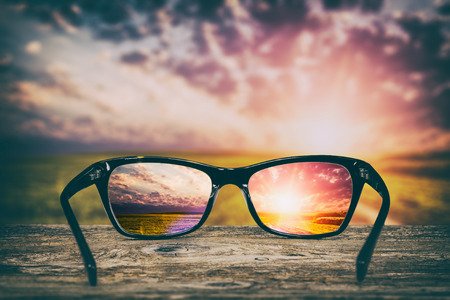 see: glasses focus background wooden eye vision lens eyeglasses nature reflection look looking through see clear sight concept transparent sunrise prescription sunset vintage sunny sun retro - stock image