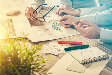 business plan: ux designer designing designers web brand phone smartphone layout geek business prototype internet goals sketch plan write idea success solution concept - stock image