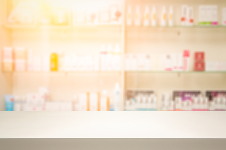 over the counter: counter store table pharmacy background shelf blurred blur focus drug medical shop drugstore medication blank medicine pharmaceutics concept - stock image