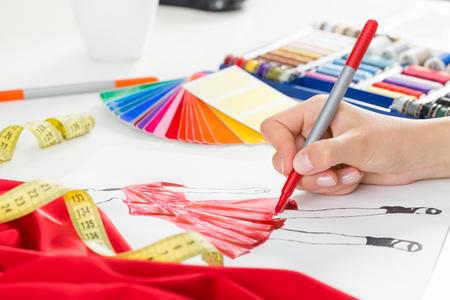 artistic designed: Fashion designer working in studio. Close up design.