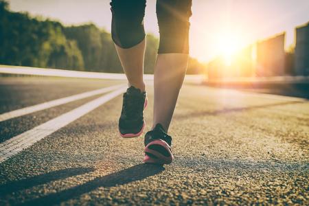 run runner sport shoe road jogging flare sunset street fitness cross sunbeam success running sportswear - stock image