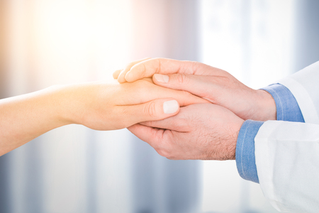 doctor patient care holding human hand trust touch medical thanks help clinic health concept - stock image Banco de Imagens